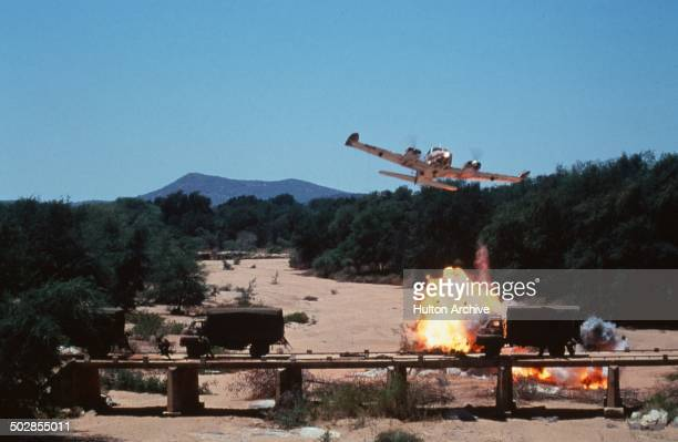 An airplane as explosions go off in a scene from the movie 'The Wild Geese' circa 1978