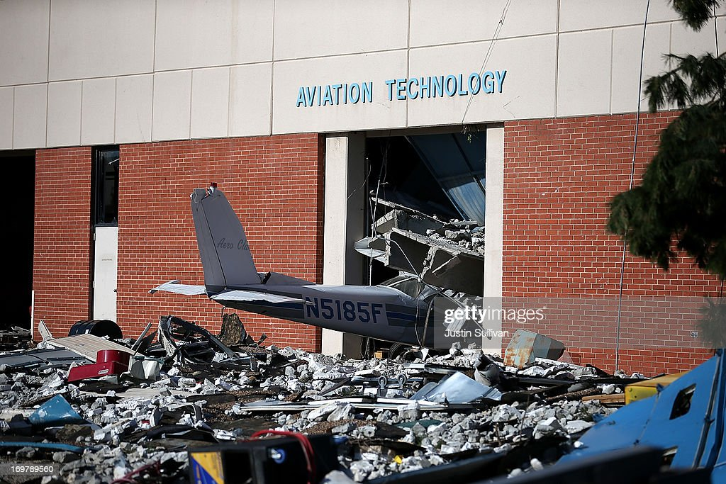 An airplane at the Canadian Valley Technology Center sits amidst rubble after it was damaged by a series of tornadoes that ripped through the area a day earlier on June 1, 2013 in El Reno, Oklahoma. A series of tornadoes ripped through the area on Friday evening killing at least nine people, injuring many others and destroying homes and buildings.