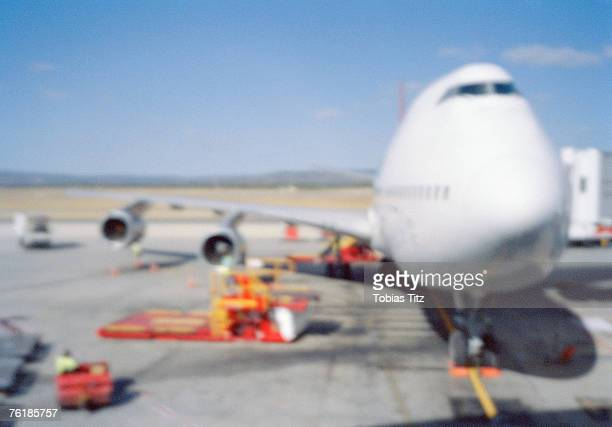 An airplane being refueled at an airport