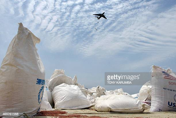 An airplane carries out an fooddrop over a field at a village in Nyal an administrative hub of Panyijar county in Unity state south Sudan spilt from...