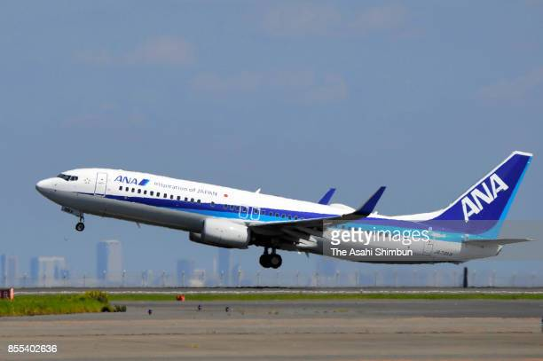 An airplane carrying Emperor Akihito and Empress Michiko takes off at Haneda International Airport on September 29 2017 in Tokyo Japan