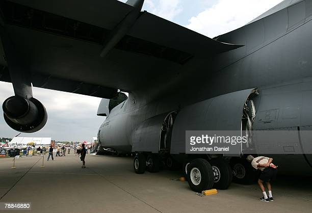 An airplane enthusiast looks into the wheel well of a C5 Galaxy one of the largest military aircraft in the world during the Experimental Aircraft...