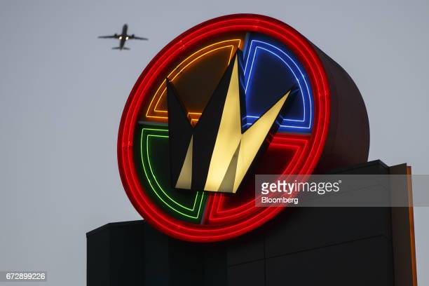 An airplane flies overhead as Regal Entertainment Group signage is displayed outside the Regal Cinemas LA LIVE Stadium 14 movie theater in Los...