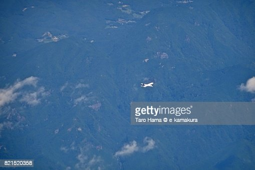 An airplane flying on mountains in Kumano city in Mie Prefecture daytime aerial view from airplane : ストックフォト