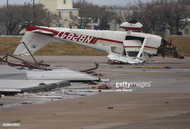 An airplane is seen flipped on its roof at the Aransas County Airport after Hurricane Harvey passed through on August 26 2017 in Rockport Texas...