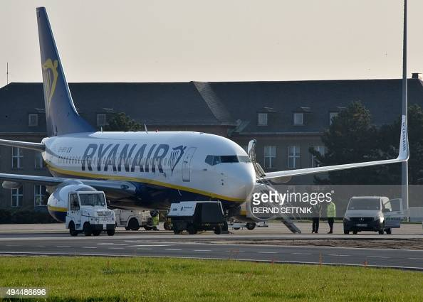 An airplane of Irish airline Ryanair is seen at Berlin Schoenefeld airport eastern Germany on October 27 2015 Ryanair opened it's sixth base in...