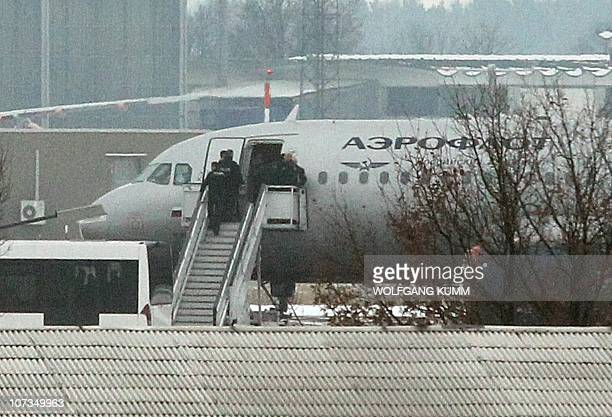 An airplane of Russian airline Aeroflot stands on a secure position of the Berlin Schoenefeld airport on December 6 2010 The plane with the flight...