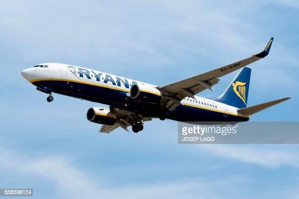 An airplane of the Irish lowcost airline Ryanair prepares to land at Barcelona's airport in El Prat de Llobregat on June 6 2016 / AFP / JOSEP LAGO