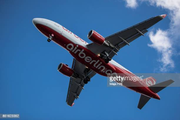 An airplane operated by German airline 'air berlin' comes in for landing at Tegel airport in Berlin on September 22 2017 in Berlin Germany