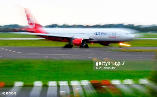 An airplane operated by German airline Air Berlin rolls on the tarmac on October 10 2017 at Duesseldorf airport western Germany Bankrupt German...