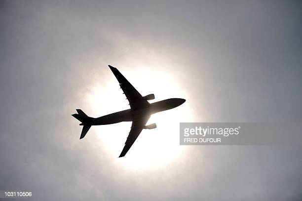 An airplane takes off at RoissyCharlesdeGaulle airport on April 21 2010 in RoissyenFrance northern Paris All longhaul passenger services to and from...