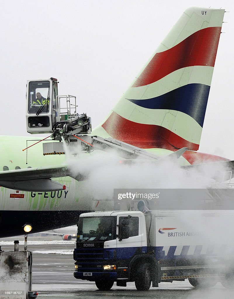An airport employee de-ices a British Airways plane on the tarmac at Heathrow airport in west London on January 19, 2013 after hundreds of flights were cancelled due to severe cold weather and snow. Passengers were forced to sleep on the floor at London's Heathrow Airport overnight, media said Saturday, after heavy snow grounded hundreds of flights and left thousands of people stranded. A spokesman for the airport, one of the busiest in the world, said a further 100 flights had been cancelled on Saturday morning, on top of about 400 that were grounded Friday by the bad weather sweeping Britain.