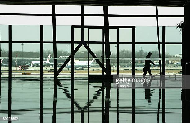 An airport employee does preparation at the new terminal building T3 at the Beijing Capital International Airport on February 28 2008 in Beijing...