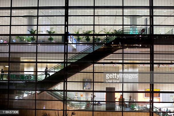 An airport security guard climbs the escalators at Ben Gurion Airport on July 7 2011 in Tel Aviv Israel Hundreds of European and North American...