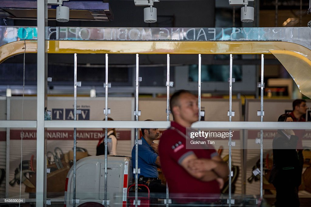 An airport security officer stands near the blast scene at the country's largest airport, Istanbul Ataturk, following yesterday's blast on June 29, 2016 in Istanbul, Turkey. Three suicide bombers opened fire before blowing themselves up at the entrance to the main international airport in Istanbul yesterday. The Istanbul Governor's Office says 41 people have been killed, 37 of the victims have been identified, including 10 foreign nationals and three people with dual citizenship. More than 230 people were wounded but 109 have been discharged from hospitals in the deadly suicide bombing attack in Istanbul's Ataturk airport blamed on the Islamic State group.