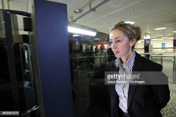 An airport worker tests out the new fast track facial recognition gates in the North Terminal of Gatwick Airport Sussex