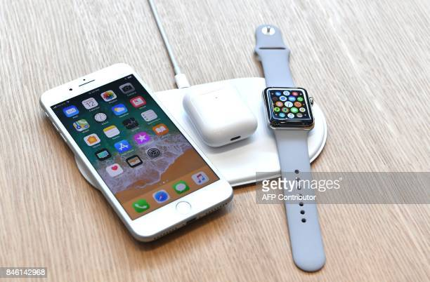 An AirPower mat is seen charging multiple devices during a media event at Apple's new headquarters in Cupertino California on September 12 2017 / AFP...