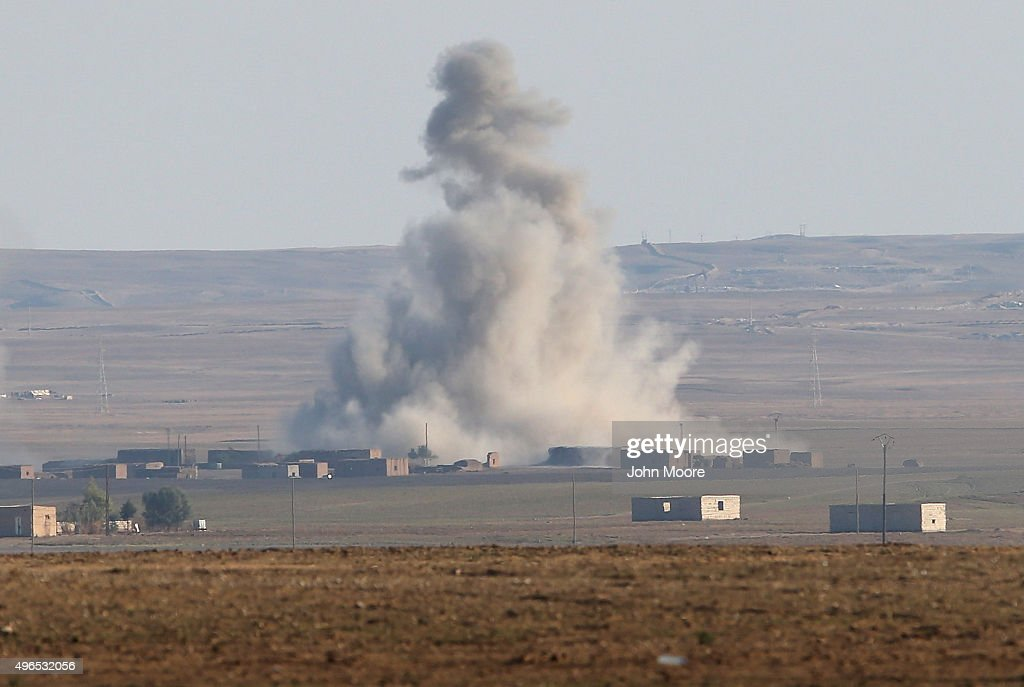 An airstrike by a US led coaltion warplane explodes on an ISIL position on November 10 2015 near the town of Hole Rojava Syria Troops from the Syrian...