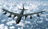 An airtoair front view of a B52G Stratofortress aircraft from the 416th Bombardment Wing armed with AGM86B AirLaunched Cruise Missiles
