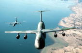 An airtoair front view of a C5B Galaxy aircraft of the 22nd Military Airlift Squadron foreground and a C141B Starlifter aircraft from the 86th...