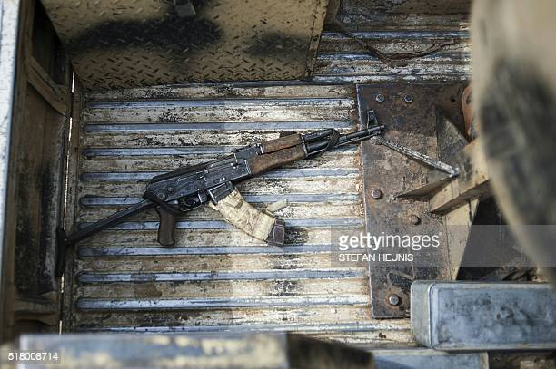 An AK47 machine gun in the back of a military vehicle in Mbalala Borno State northeast Nigeria on March 25 2016 On April 14 Boko Haram militants...