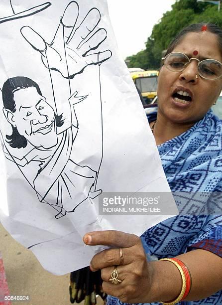 An Akhil Bharatiya Vidyarthi Parishad All India Students Forum activist carrying a cartoon shouts slogans marching down the busy MG Road during a...