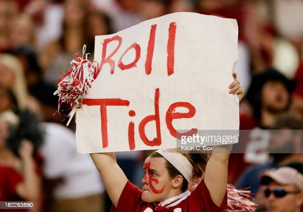An Alabama Crimson Tide fan holds up a 'Roll Tide' sign during the game against the Mississippi Rebels at BryantDenny Stadium on September 28 2013 in...