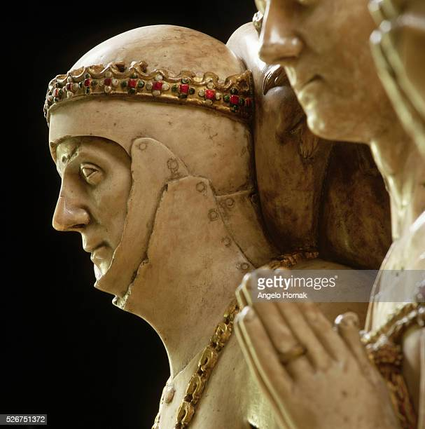 An alabaster effigy of The Duke of Clarence Henry V's brother who was killed in the Battle of Bauge in 1421 in early 15th century full plate armor...