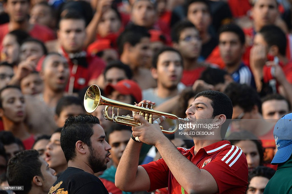 An Al-Ahly fan blows his trumpet prior to their African Champions League second leg final, Egypt's Al-Ahly versus South Africa's Orlando Pirates in Cairo, on November 10, 2013. The sides drew 1-1 in the first-leg of the CAF Champions League Final on November 2 at Orlando Stadium in Johannesburg.