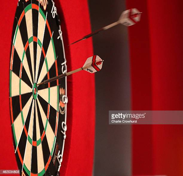 An Alan Norris of England's dart flies into the board during the final against Stephen Bunting of England during the BDO Lakeside World Professional...