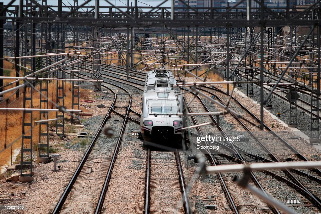 An Alaris regional train operated by Renfe Operadora SC arrives at Joaquin Sorolla train station in Valencia, Spain, on Saturday, Aug. 3, 2013. Spain's state-owned rail operator Renfe plans to cut almost 500 jobs, or 4% of staff, as early as this year, ABC reports, citing comments by Public Works Minister Ana Pastor. Photographer: Antonio Heredia/Bloomberg via Getty Images