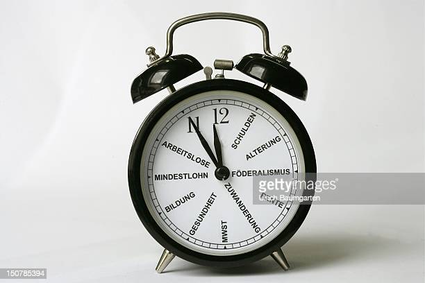 An alarm clock Symbolic image to lick the republic into shape