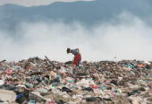 An Albanian girl sifts through trash at a garbage dump in the outskirts of Tirana on July 7 2008 in search of anything valuable to sell Tirana does...