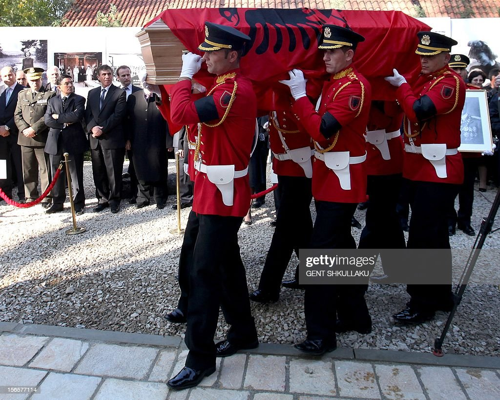 An Albanian honour guards carries the coffin with the remains of Albania's self-proclaimed king Zog I, during the reburial ceremony in Tirana on November 17, 2012. Thousands of Albanians turned out today to pay their respects to the late self-proclaimed king Zog I, whose remains are to be reburied with state honours after they were returned from France where he died in exile in 1961.