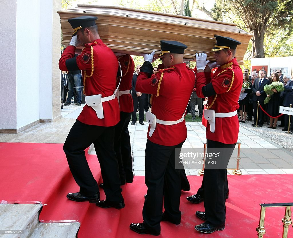 An Albanian honour guards carries the coffin with the remains of Albania's self-proclaimed king Zog I, during the reburial ceremony in Tirana on November 17, 2012. Thousands of Albanians turned out Saturday to pay their respects to the late self-proclaimed king Zog I, whose remains are to be reburied with state honours after they were returned from France where he died in exile in 1961. AFP PHOTO / GENT SHKULLAKU