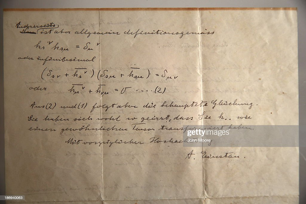 An Albert Einstein letter stands on display ahead of an auction by the Guernsey's Auction House on November 4, 2013 in New York City. Two letters, penned by Einstein in 1938, will be auctioned on November 7 at New York City's Arader Galleries. In the letters, Einstein admits in writing that a graduate student better understood the calculus for what Einstein would later create a unified theory of gravity and electromagnetic fields.