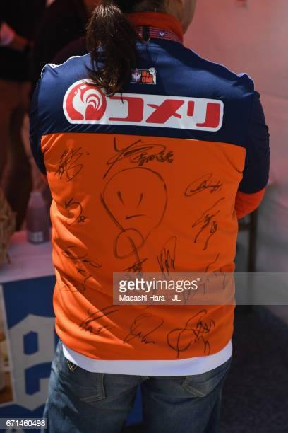 An Albirex Niigata fan in autographed jersey looks on prior to the JLeague J1 match between Albirex Niigata and FC Tokyo at Denka Big Swan Stadium on...
