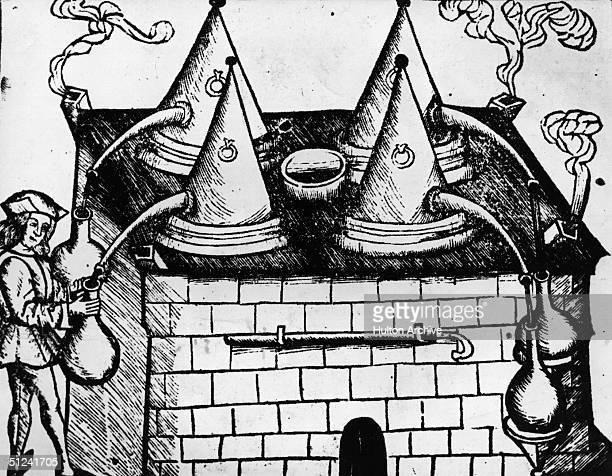 1519 An alchemist using distillation apparatus Original Publication From H Brunschwick's 'Buch Zu Distillieren' pub in Strasbourg