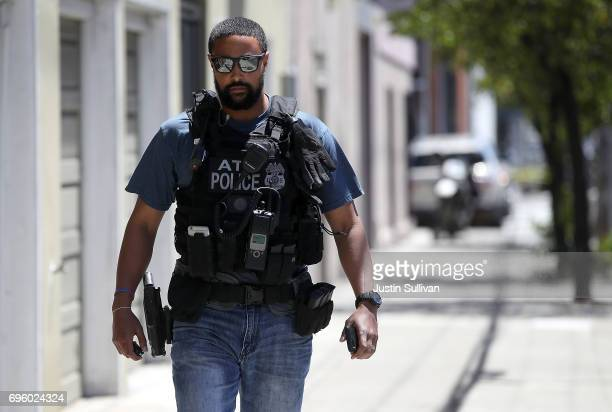 An Alcohol Tobacco and Firearms officer walks at the scene of a shooting at a UPS facility on June 14 2017 in San Francisco California At least four...