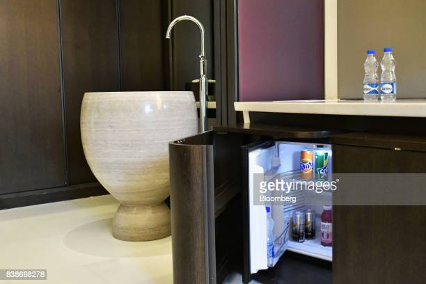 An alcoholfree mini bar is arranged for a photograph inside a guest room of the Roseate New Delhi hotel operated by the Bird Group in New Delhi India...