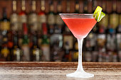 An alcoholic cosmopolitan cocktail is on the bar. Space for text. Photo for the menu