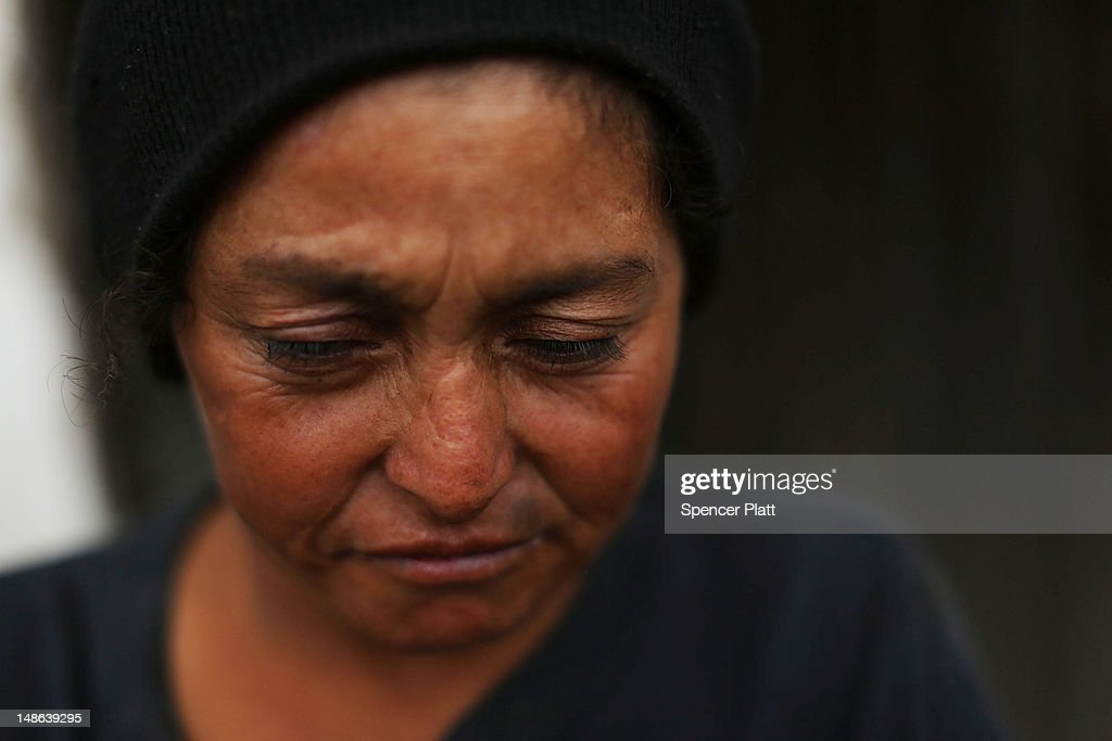 An alcoholic woman stands outside of a bar on July 18 2012 in Tegucigalpa Honduras Honduras now has the highest per capita murder rate in the world...