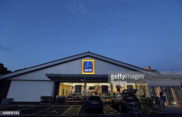 An Aldi logo sits illuminated above the windows of an Aldi discount supermarket operated by Aldi Stores Ltd at dusk in Chelmsford UK on Tuesday Oct 7...