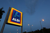 An Aldi logo sits illuminated on a sign outside an Aldi discount supermarket operated by Aldi Stores Ltd at dusk in Chelmsford UK on Tuesday Oct 7...