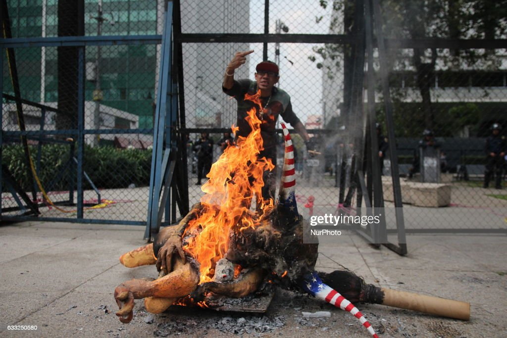 An alebrije, or sculpture of a fantastical creature, representing U.S. President Donald Trump with horns and a tail burns in front of the U.S. Embassy in Mexico City, Tuesday, Jan. 31, 2017. Thousands protested in the capital Tuesday, as rural residents from across the country denounced a gasoline price hike that has raised the price of tractor fuel, protested the governments of Mexico and the U.S., and called for the renegotiation of NAFTA to make it more favorable to small farmers.