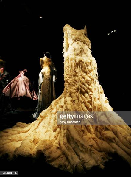 An Alexander McQueen 'Oyster' dress is displayed at the 'Blogmode addressing fashion' exhibit at the Metropolitan Museum of Art's Costume Institute...