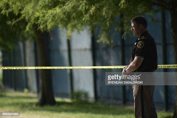 An Alexandria police officer stands near the crime scene of an early morning shooting in Alexandria Virginia June 14 2017 Senior Republican...