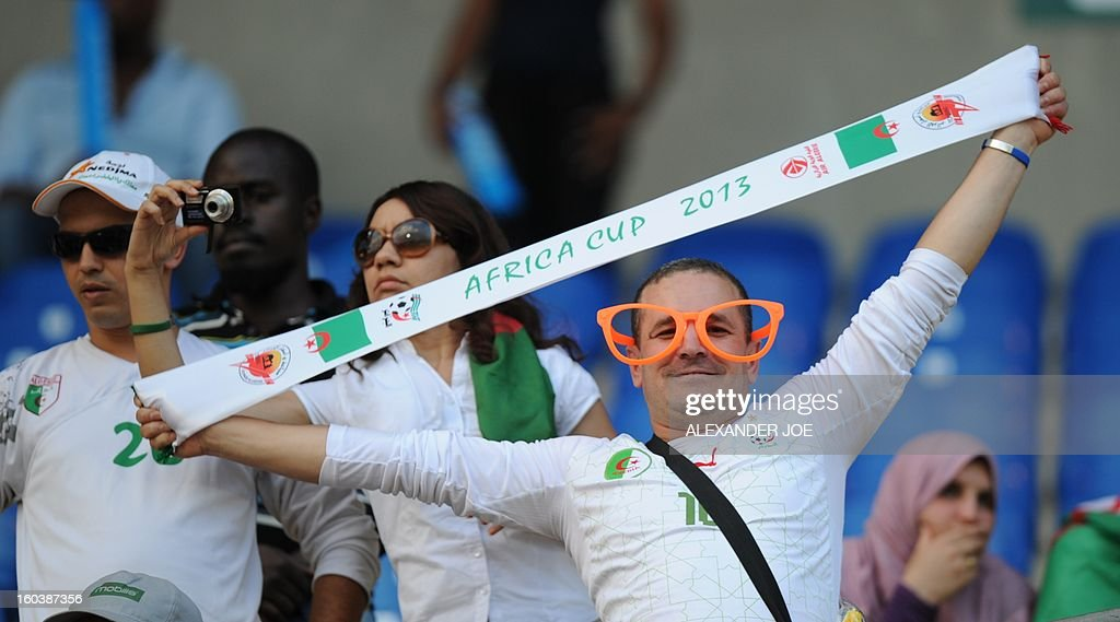 An Algeria fan smiles on January 30, 2013 as his national team plays against Ivory Coast during a 2013 African Cup of Nations Group D football match at the Royal Bafokeng stadium in Rustenburg. JOE