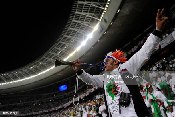 An Algeria fan with his vuvuzela before the start of the 2010 FIFA World Cup South Africa Group C match between England and Algeria at Green Point...