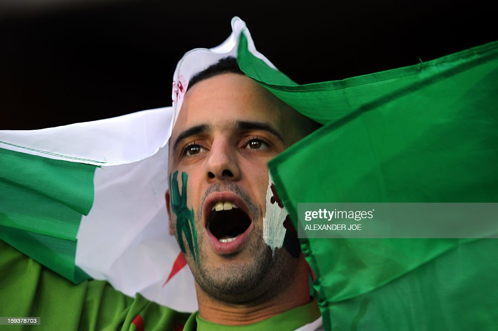 An Algerian fan cheers during a friendly football match between South Africa's Bafana Bafana and Algeria in Soweto on January 12 , 2013, ahead of the 2013 African Cup of nation that will take place in South Africa from January 19 to February 10.